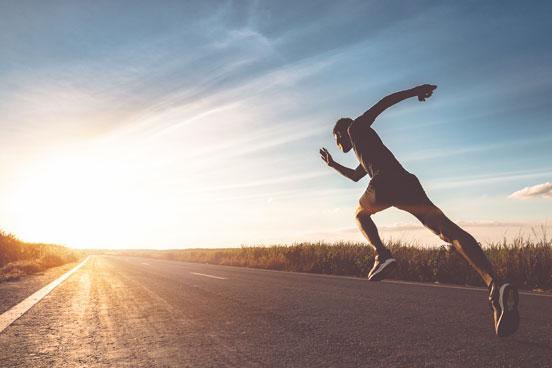 Man-running towards the sunset