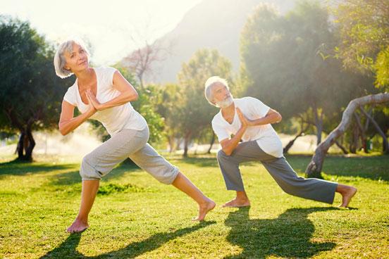 Mand and Woman doing yoga outside