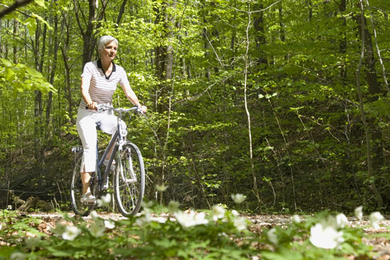 Woman biking outdoors